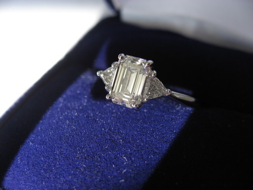in medias res emerald cut with trillion cut side